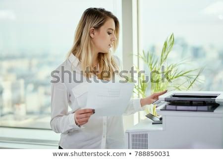 Femme d'affaires regarder imprimante machine bureau Photo stock © AndreyPopov