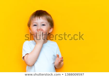 shocked little boy closing his mouth by hands Stock photo © dolgachov