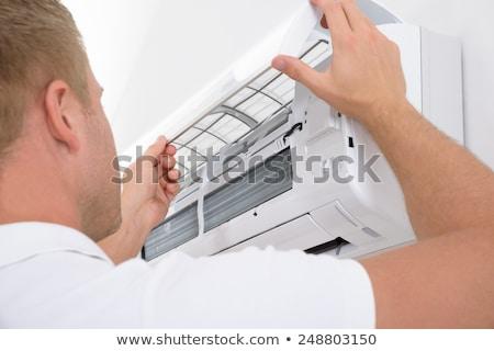Uomo aria condizionata muro lavoro sfondo servizio Foto d'archivio © AndreyPopov