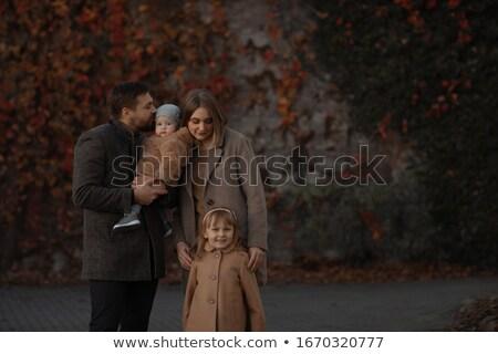 Family photo in warm dark tones. Stock photo © ElenaBatkova