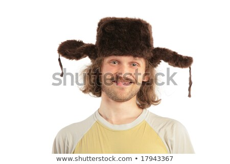 long-haired smiling Russian man in cap with ear-flaps Stock photo © Paha_L