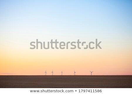 Stock photo: aerogenerator windmills on sunset sky