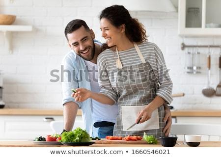 sorridente · mulher · jovem · salada · retrato · cozinha · comida - foto stock © Rob_Stark