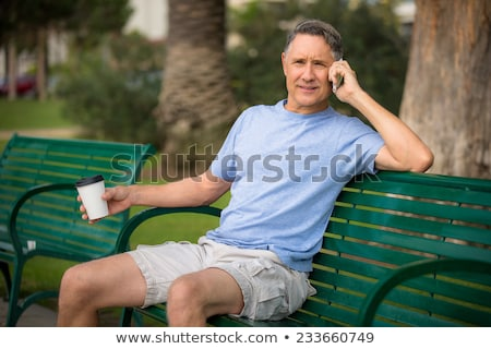 man making call in park stock photo © photography33