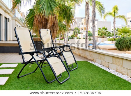 resort - loungechairs at poolside courtyard 2 Stock photo © tdoes