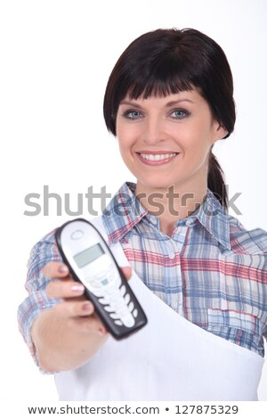 brunette with blue eyes and cordless phone Stock photo © photography33