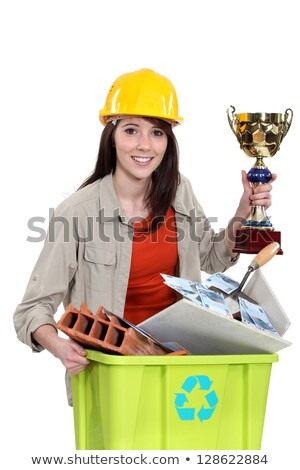 Female builder holding award for recycling Stock photo © photography33