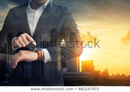Businessman in hurry watching his clock. Stock photo © Reaktori