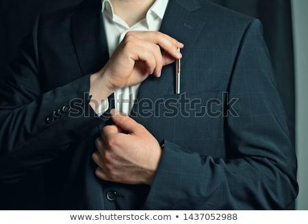 Businessman in formals with handcuffs Stock photo © wavebreak_media