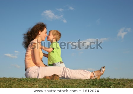 Mother with son on sundown kiss by nose after one year Stock photo © Paha_L
