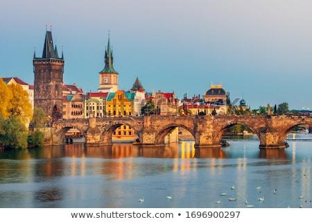 Sunset on the Charles bridge; Czech Republic Stock photo © tannjuska