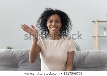 beautiful afroamerican woman on a sofa stock photo © giulio_fornasar