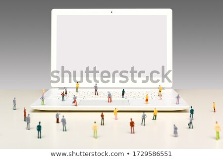 miniature business people standing on laptop keyboard stock photo © kirill_m