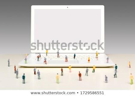 Miniature business people standing on laptop keyboard Stock photo © Kirill_M