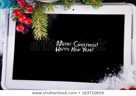 tablet pc with christmas decorations on white background Stock photo © manaemedia