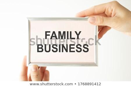 Familie business handen munten geïsoleerd witte Stockfoto © fantazista