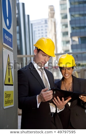 attractive women relax on construction site stock photo © aikon