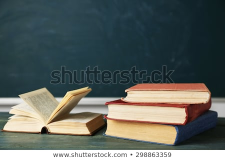 Stock photo: Book Stack on Desk with Chalkboard Background - Vintage Style