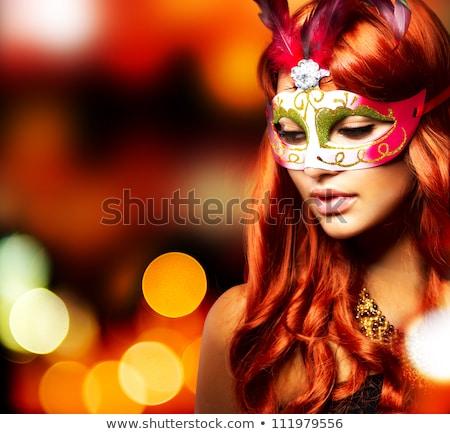 beautiful woman in carnival mask stock photo © alphaspirit