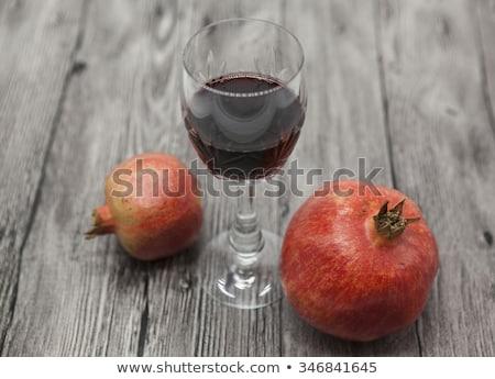 Twee vruchten sappig spaans granaatappel donkere Stockfoto © mcherevan