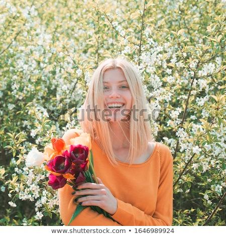 Csinos lány tulipánok puha nő virág Stock fotó © vapi