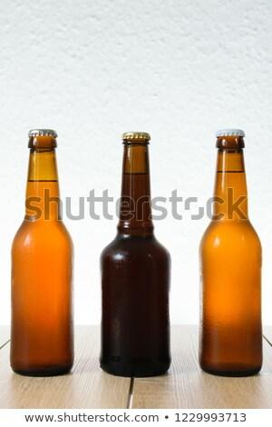 Vidro fresco cerveja boné espuma isolado Foto stock © paulovilela