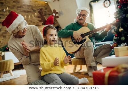woman having fun with her guitar stock photo © giulio_fornasar