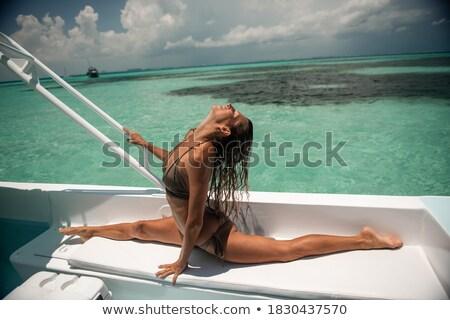 Gyönyörű fiatal nő úszik csodálatos tiszta tenger Stock fotó © Massonforstock