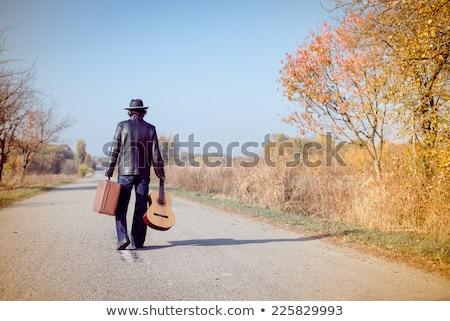 Férfi bőrdzseki sétál vidéki út hideg kezek Stock fotó © feedough