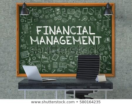 Green Chalkboard with Hand Drawn Financial Management. Stock photo © tashatuvango