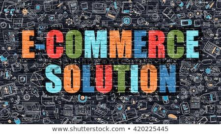 solution for e commerce concept multicolor on dark brickwall stock photo © tashatuvango
