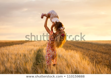 Mother and daughter playing in a field Stock photo © IS2
