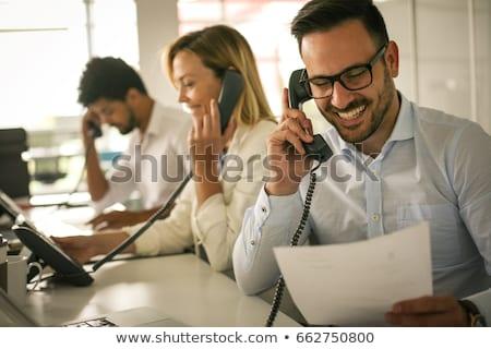 молодым человеком сидят служба говорить телефон рабочих Сток-фото © Traimak