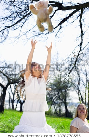 Girl Holding Her Teddy Bear Up In The Air Stock photo © stuartmiles