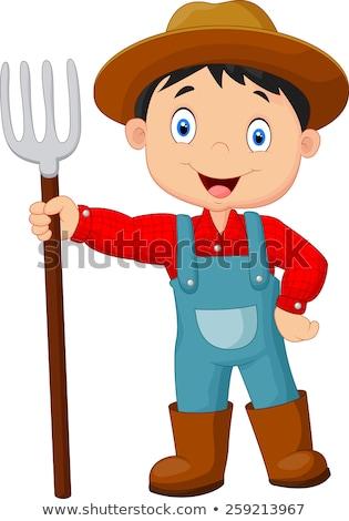 A farmer holding rake Stock photo © colematt