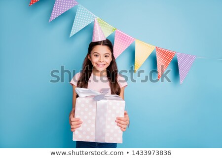 Brunette girl with long hair getting presents on birthday.  Stock photo © studiolucky