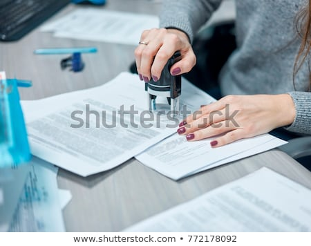 Businesswoman Putting Stamp On Documents Stock photo © AndreyPopov