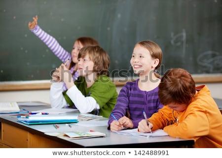Alegre estudantes as mãos levantadas olhando laptop Foto stock © pressmaster