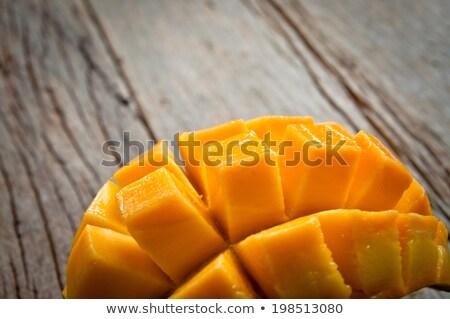 Organikus mangó kezek öreg fából készült trópusi Stock fotó © galitskaya