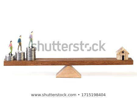 Stacked Of Coins And Miniature House On Wooden Seesaw Stock photo © AndreyPopov