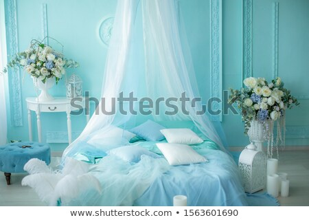 Bedroom decoration in soft blue tones with candles Stock photo © ElenaBatkova