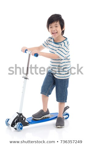 Boy playing scooter on isolated background Stock photo © bluering