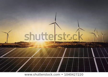 Solar system and wind power turbines  Stock photo © elxeneize