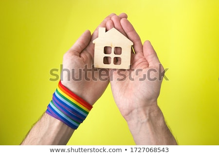 male couple with gay pride rainbow wristbands Stock photo © dolgachov