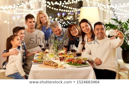 happy family having dinner party at home Stock photo © dolgachov