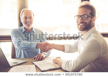 senior businessman with a young colleague stock photo © photography33