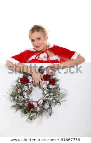 woman dressed as mrs claus and holding a wreath stock photo © photography33