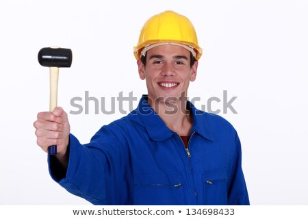 Eager young worker holding rubber mallet Stock photo © photography33