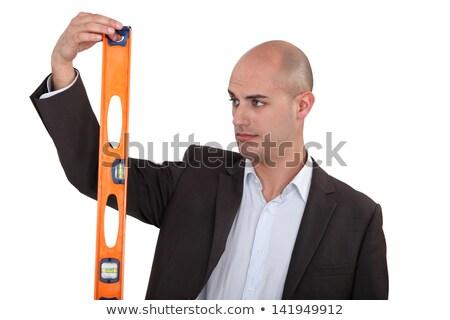 Uomo suit guardare spirito livello industria Foto d'archivio © photography33