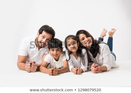 happy indian family with two children stock photo © szefei